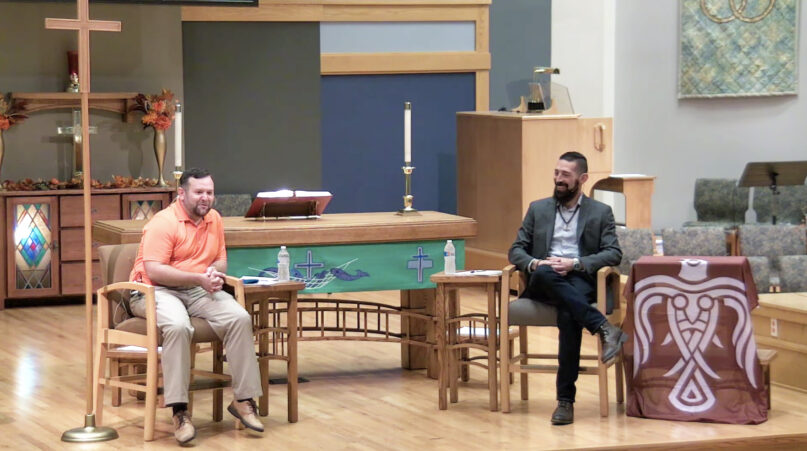 """The Rev. Andy Behrendt of Trinity Lutheran Church (left) and the Rev. Ethan Stark of Heathens Against Hate (right) host """"A Pagan and a Pastor: A Necessary Conversation,"""" on Sept. 30, 2021, inside Trinity's sanctuary in Waupaca, Wisconsin. Screen grab from YouTube"""