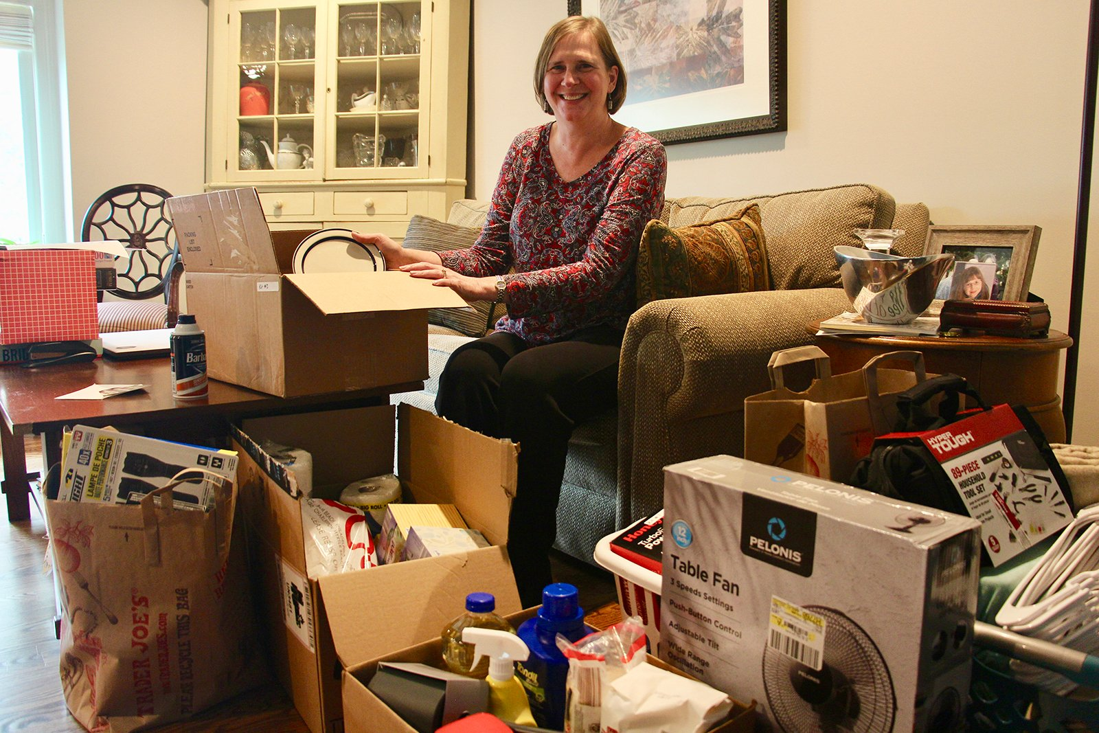 Amy Treier shows off donations for World Relief welcome kits collected by members of Immanuel Presbyterian Church in Warrenville, Illinois, stored at her home in the Chicago suburbs on Sept. 23, 2021. RNS photo by Emily McFarlan Miller