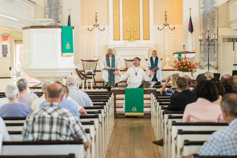 The Rev. Mark Salvacion, center, speaks during a service at Historic St. George's United Methodist Church in Philadelphia. Photo by David Fonda, courtesy of HSG