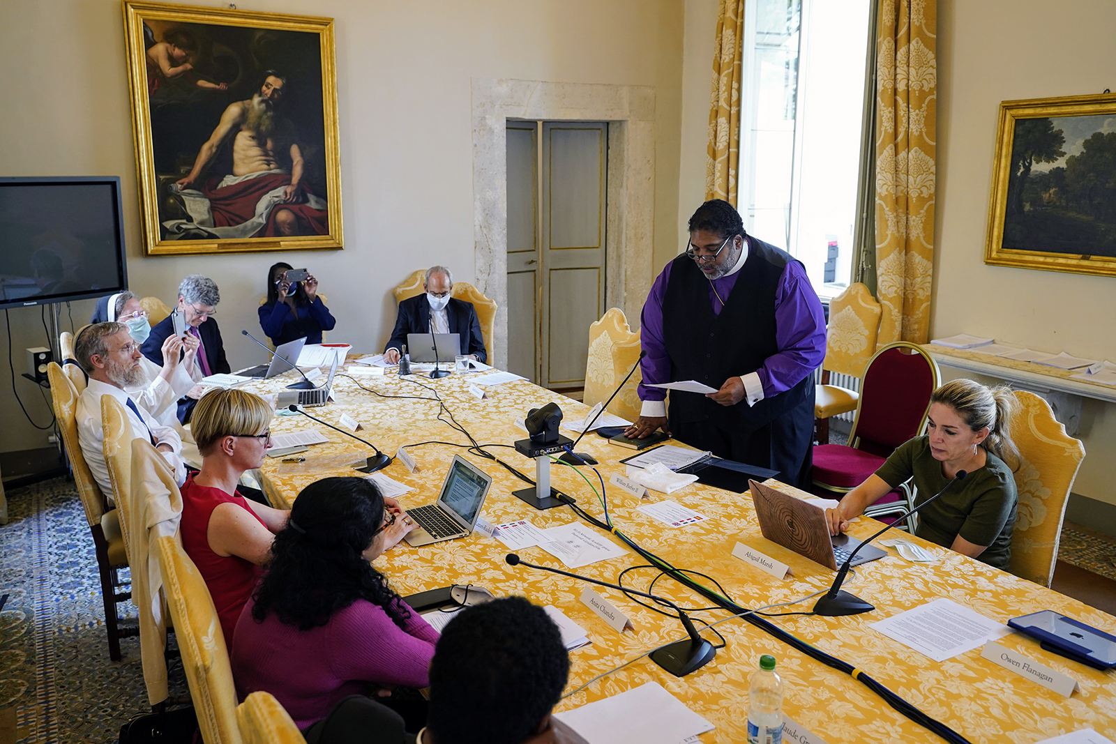 """The Rev. William Barber II, standing, addresses the poverty conferency titled """"Caritas, Social Friendship, and the End of Poverty,"""" organized by the Pontifical Academy of Social Sciences, at the Vatican, Monday, Oct. 4, 2021.Photo by Gabriella Clare Marino"""