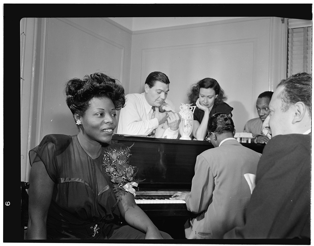 Portrait of Mary Lou Williams, left, at her apartment in New York, New York, circa Aug. 1947. Photo by William P. Gottlieb/LOC/Creative Commons